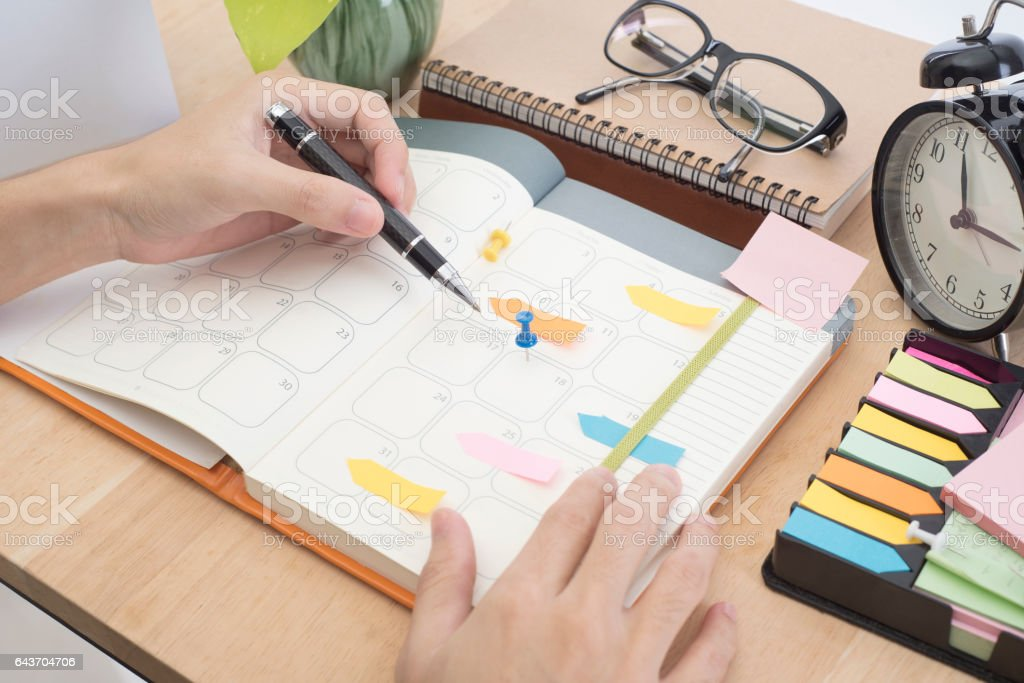 business hand write calender planner meeting on desk office. stock photo