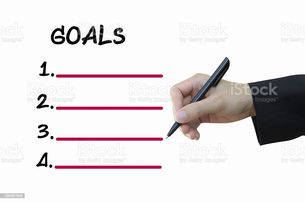 Business hand writing goals stock photo