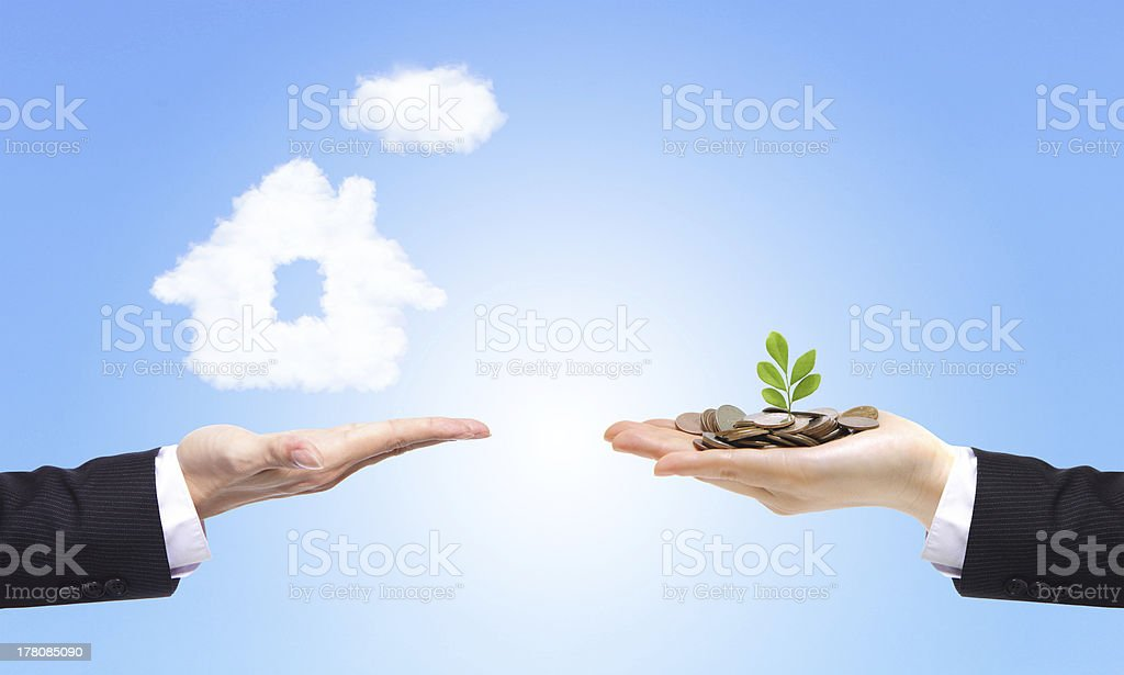 business Hands with money and house stock photo