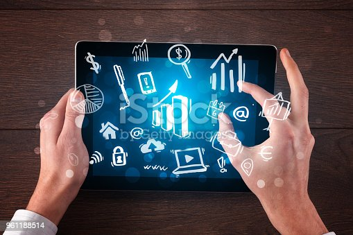 613550610istockphoto Business hands working on tablet 961188514