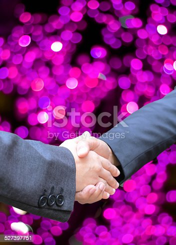 istock Business handshake and blur lighe background 527397751