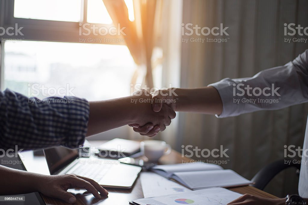 Business handshake and business dealings royalty-free stock photo