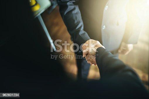 istock Business handshake and business people. 962601234