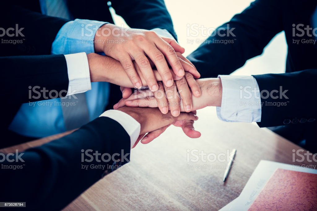 business handshake and teamwork for achievement KPI and goal stock photo
