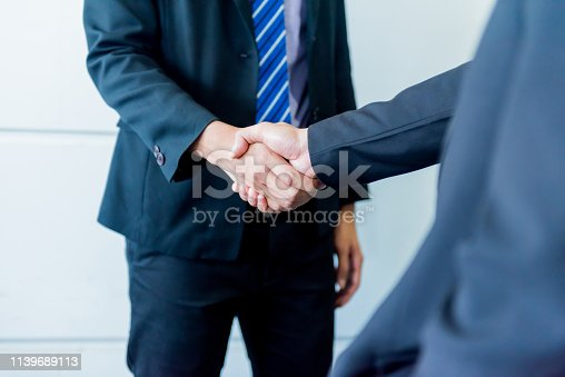 istock business handshake and teamwork for success and goal 1139689113