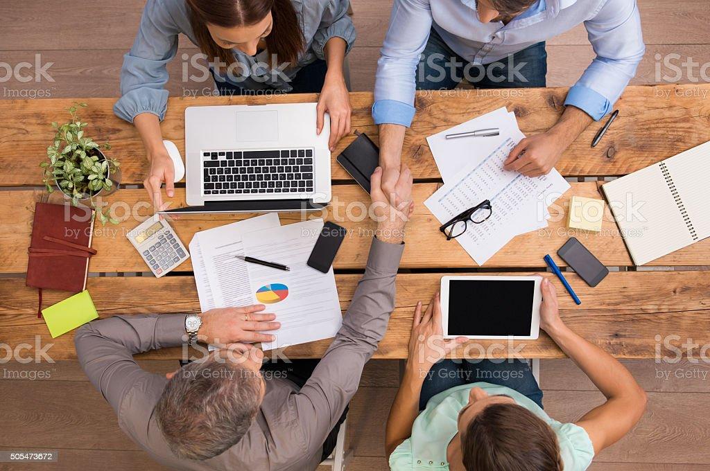 Business handshake at work stock photo