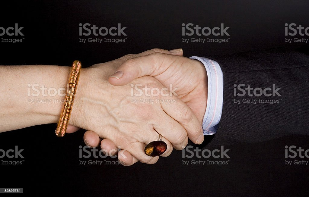Business handshake between man and wife. royalty-free stock photo