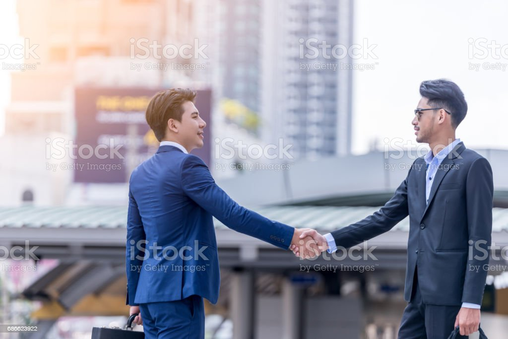 Business handshake concept. shaking hand of two businessman closing a deal city background royalty-free stock photo