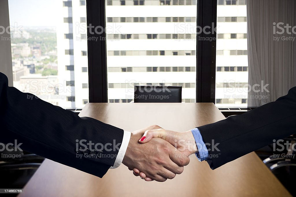 Business handshake deal in an office royalty-free stock photo