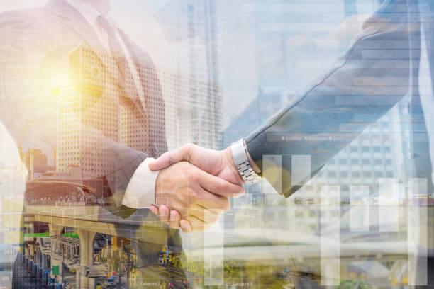 business handshake for successful - double exposure стоковые фото и изображения
