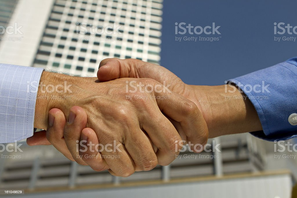 Business handshake in a financial district royalty-free stock photo