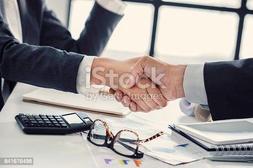 1008974324 istock photo Business handshake in the office 841676498