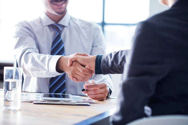 business handshake in the office - stock broker stock photos and pictures