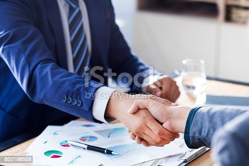 1008974324 istock photo Business handshake in the office 855198558