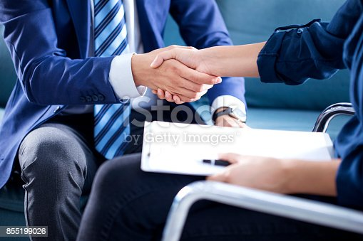 1008974324 istock photo Business handshake in the office 855199026