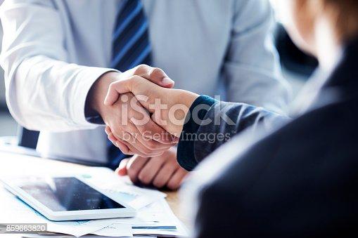 1008974324 istock photo Business handshake in the office 859663820