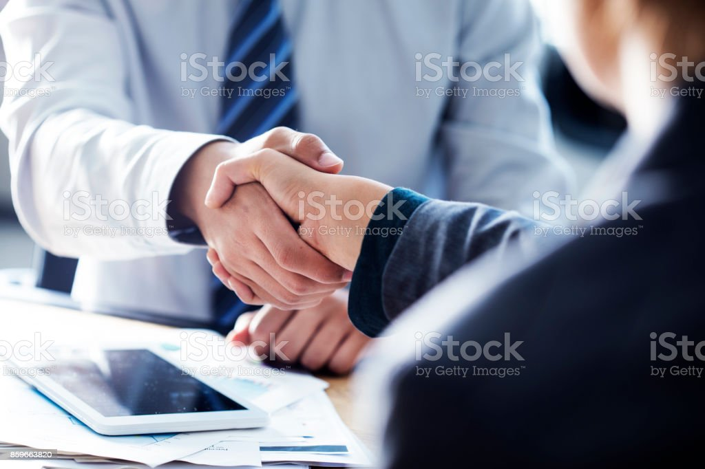 Business handshake in the office stock photo