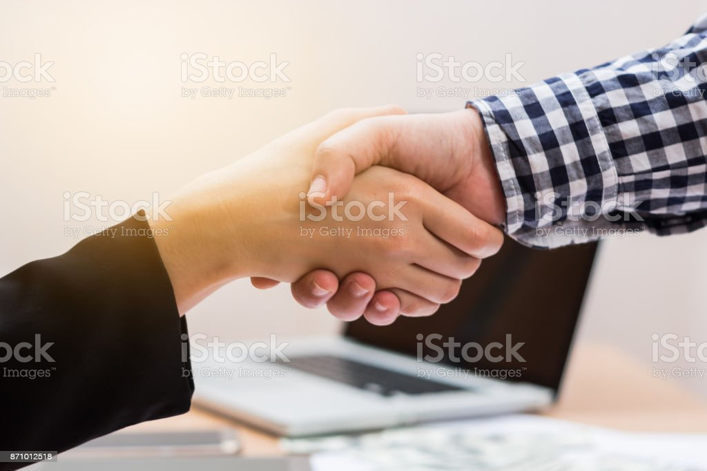 Business handshake in working space for business success concept stock photo