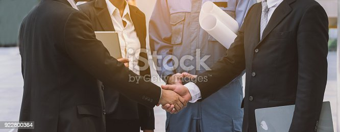 istock business handshake. Investor and contractor shaking hands, 922800364