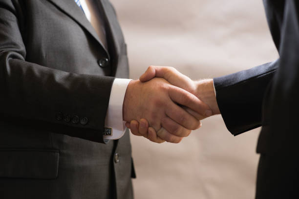 Business handshake of two businessmen in suits, negotiate and make a deal Business handshake of two businessmen in suits, negotiate and make a deal. diplomacy stock pictures, royalty-free photos & images