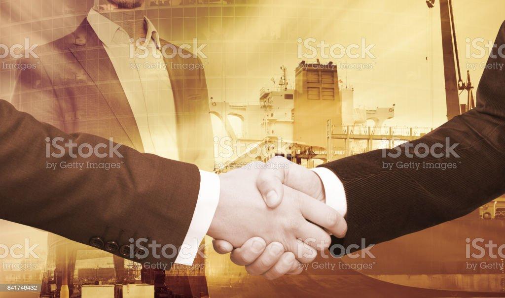 Business handshake on crane background stock photo