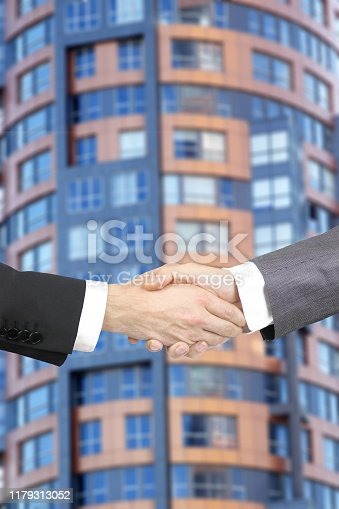 1055059750istockphoto Business handshake 1179313052