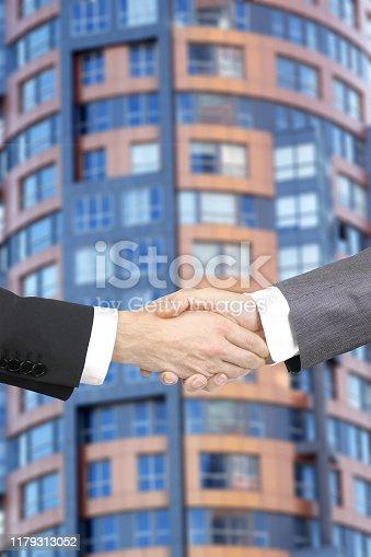 1055059750 istock photo Business handshake 1179313052