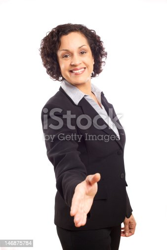 Smart dynamic attractive business woman offering handshake.  Focus on woman's face.
