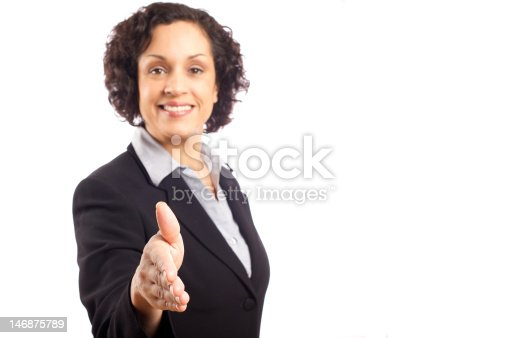 Smart dynamic attractive business woman offering handshake.  Focus on hand.