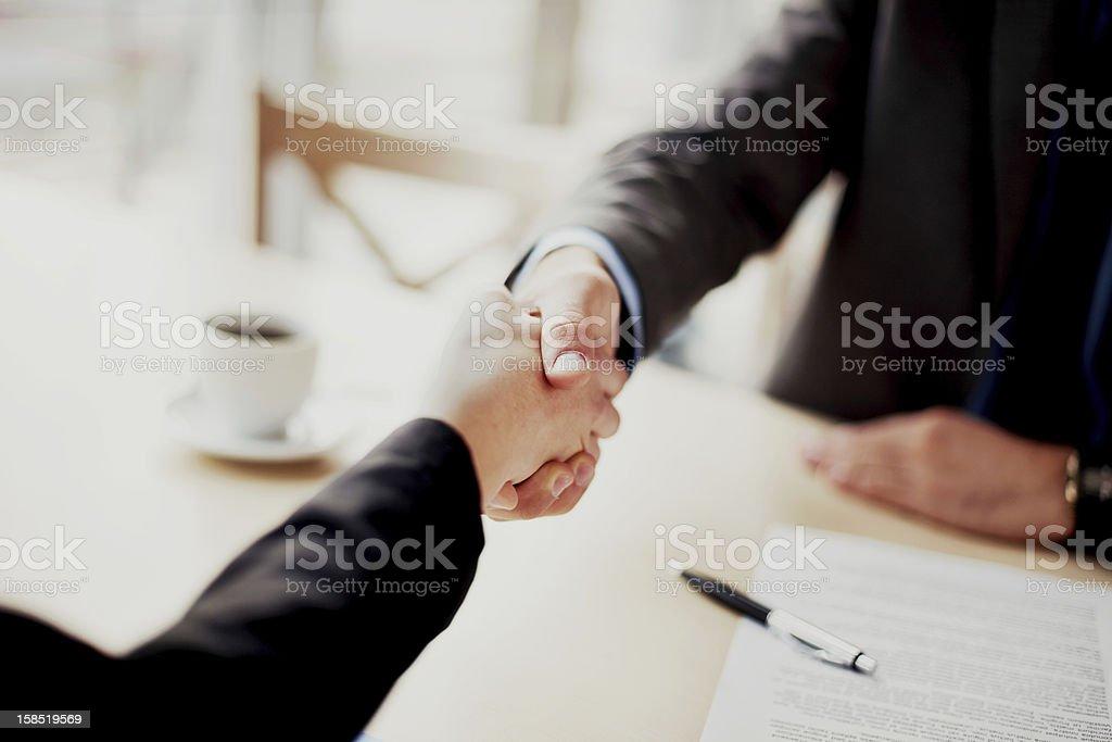 Business Handshake Handshake closeup of businesswoman and businessman. Adult Stock Photo