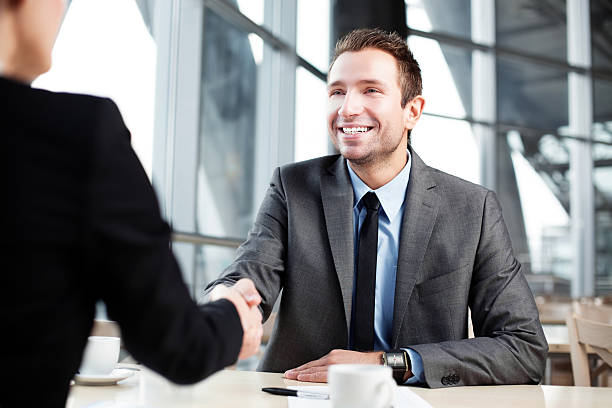 business handshake - gripping stock photos and pictures