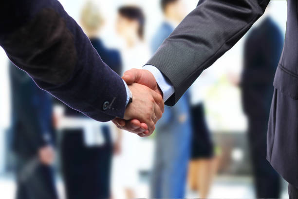Business handshake. Two businessman shaking hands with each other in the office – zdjęcie