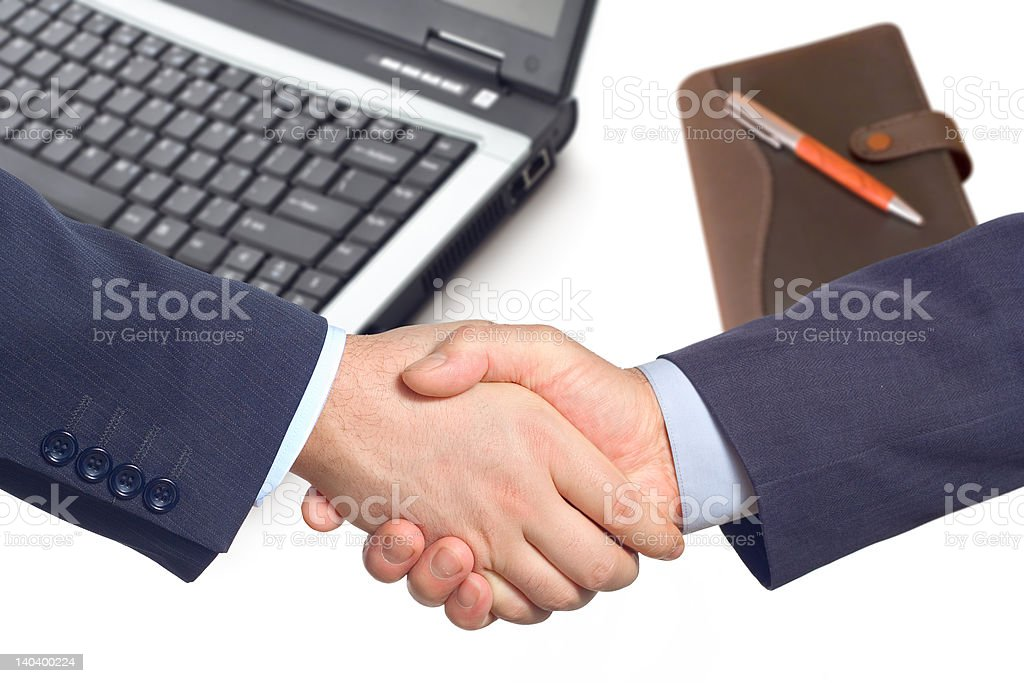Business handshake  with laptop and notepad royalty-free stock photo