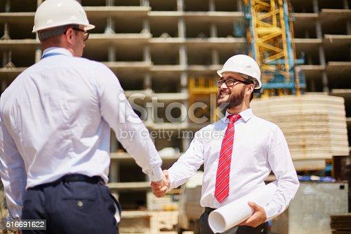istock Business handshaking 516691622