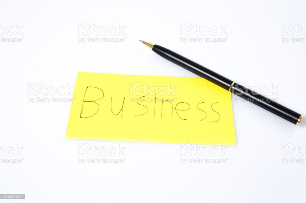 Business handwtrite with a pen on a yellow paper compsoition stock photo