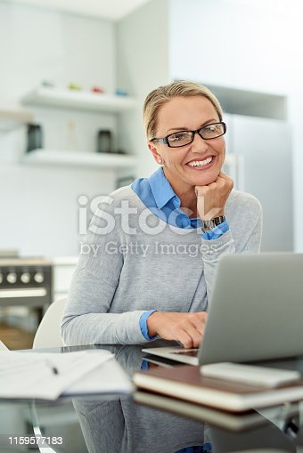 Cropped portrait of an attractive mature businesswoman working on her laptop in the office at home