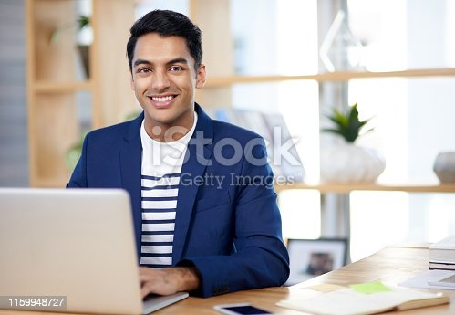 Portrait of a handsome young businessman working in an office