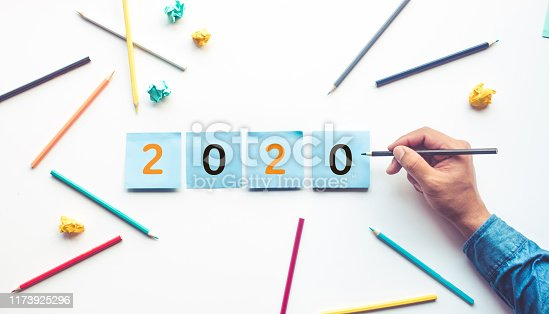 926239360 istock photo Business ideas 2020 with male hand and pencil,notepaper. 1173925296
