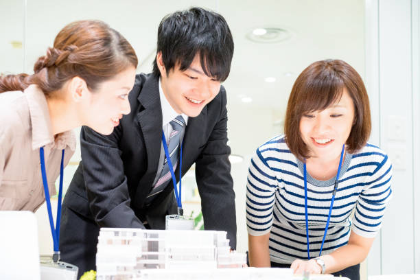 Business image (architect, architectural model, meeting) Business image (architect, architectural model, meeting) image. japanese ethnicity stock pictures, royalty-free photos & images