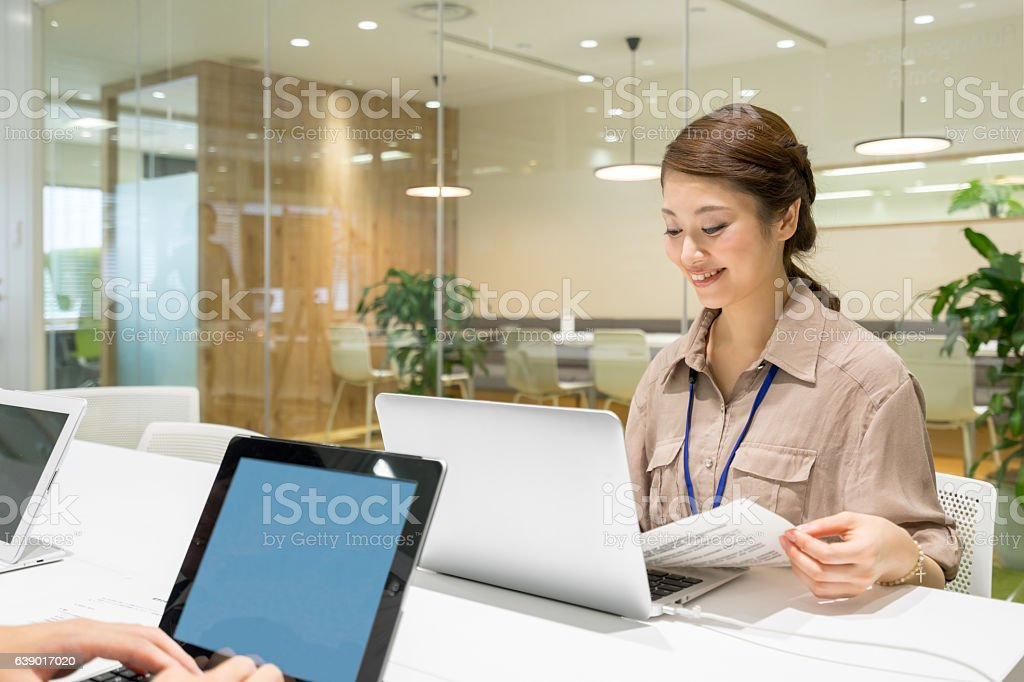 Business image (women · conference · meeting · presentation) ストックフォト