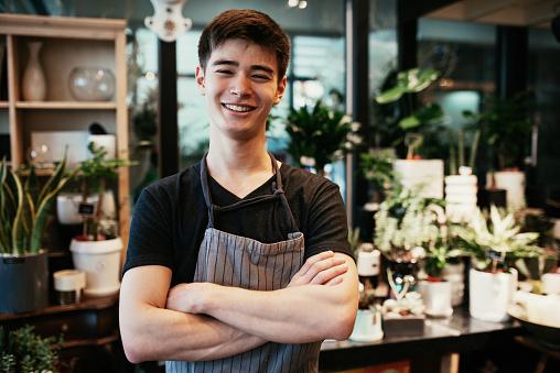 Millennial Korean man running flower shop business