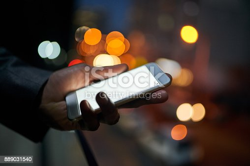 Cropped shot of a businessman using a digital tablet at night