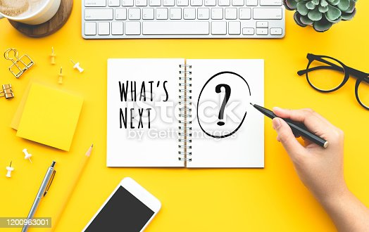 Business inspiration concepts with woman writing What's next? text on papernote.Strategy and vision for work