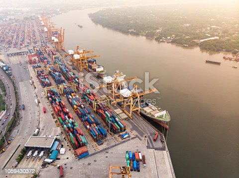 istock Business International trade and Container logistics export-import harbor to the International port / Shipping Containers - Bird's-eye view from drone. 1059430372