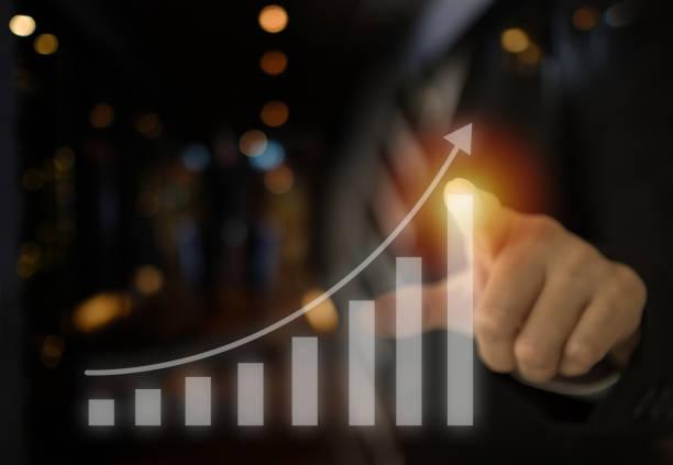 unternehmenswachstum investitionen - messlatte stock-fotos und bilder