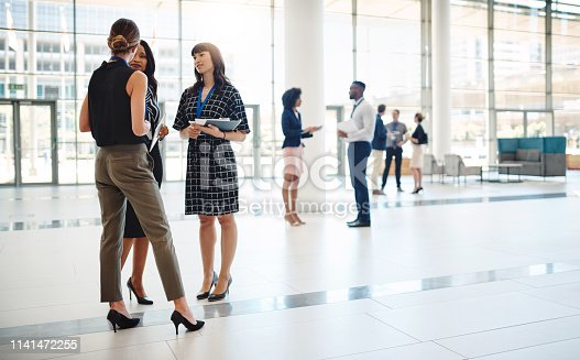 Shot of businesspeople networking at a conference