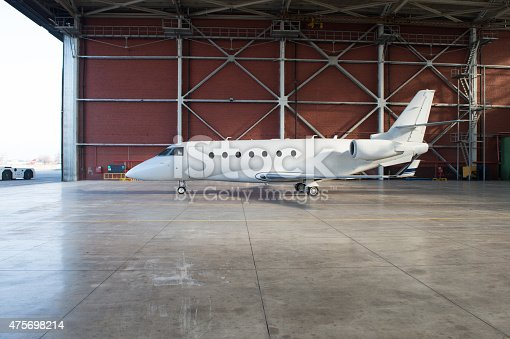 istock Business jet airplane is in hangar. 475698214