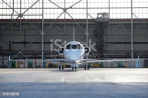 istock Business jet airplane is in hangar. 475716218
