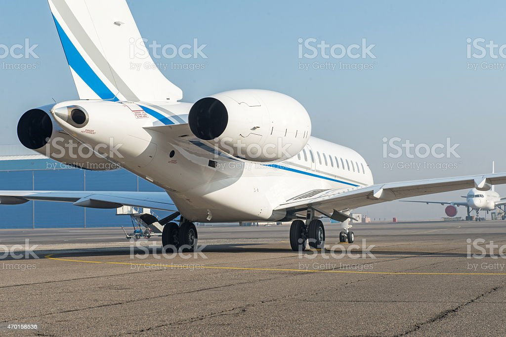 Business jet airplane on the ground. stock photo