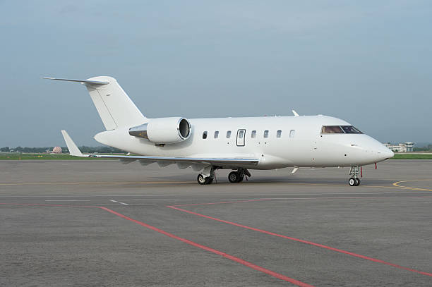 Business jet airplane on the ground stock photo